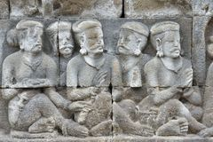 Detail of Buddhist carved relief in Borobudur temple Stock Photos