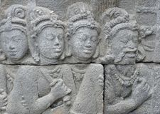 Detail of Buddhist carved relief in Borobudur temple Royalty Free Stock Images