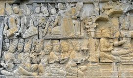 Detail of Buddhist carved relief in Borobudur temple. Detail of Buddhist carved relief in Borobudur temple in Yogyakarta, Java, Indonesia Royalty Free Stock Photo