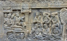 Detail of Buddhist carved relief in Borobudur temple. Detail of Buddhist carved relief in Borobudur temple in Yogyakarta, Java, Indonesia Stock Images