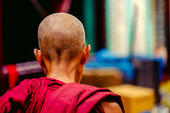 Detail of buddhist monk in a robe from behind Royalty Free Stock Photos
