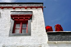 Detail of a Buddhist temple with two monks Royalty Free Stock Images