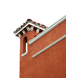 Detail of Building Corner. Corner of red Spanish building, with tile roof and white trim royalty free stock photos