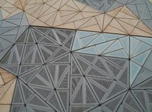 A detail of a building on Fed square in Melbourne. Federation square with a building with a decorative sandstone front in Melbourne in Victoria in Australia royalty free stock photography