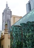 A detail of a building on Fed square in Melbourne. Federation square in front and the forum theatre and Collins street in the back stock photos