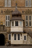 Detail of a Building. An old historical building with interesting decorations and a delightful cupola entrance sits in the main street of the town of Aalborg in Royalty Free Stock Photos