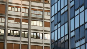 Detail of the building. Two different buildings with lots of windows Royalty Free Stock Images