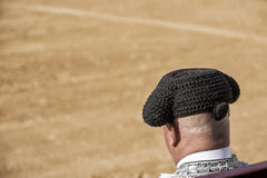 Detail of Bullfighter bald and slightly fat looking the bull dur Royalty Free Stock Photo