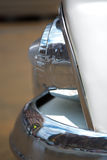 Detail of the bumper and the light bulb of an American vintage c Stock Photography