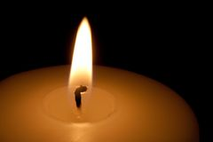Detail of a burning candle in the dark Stock Photography