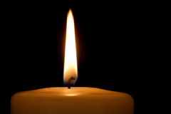 Detail of a burning candle in the dark Stock Photos