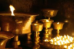 Detail of burning candles in buddhist monastery Royalty Free Stock Photo