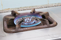 Detail of a burning gas stove with blue flames.  Royalty Free Stock Photos