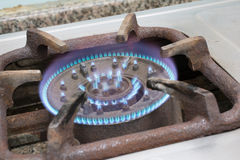 Detail of a burning gas stove with blue flames.  Royalty Free Stock Photography