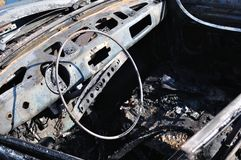 Detail of burnt car wreck in accident Royalty Free Stock Photos