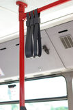 Detail of bus interior, handrails. Handles for standing passenger inside a city-bus stock photos
