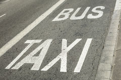 Detail of bus and taxi`s exclusive road in Barcelona, Spain Stock Images