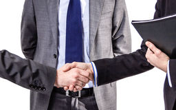 Detail of business handshake for a closing deal Royalty Free Stock Photos