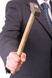 Businessman with hammer. Royalty Free Stock Image