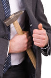 Businessman with hammer. Royalty Free Stock Photos