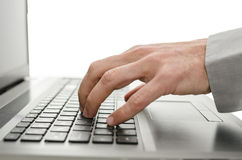 Detail of business man hand using laptop Stock Photo
