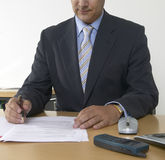 Detail of a business man with pen and papers Stock Image