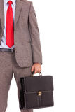 Detail of business man's suit and briefcase. Detail of a business man's suit and tie with briefcase. cutout picture of a business man holding a briefcase Stock Photos