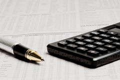 Detail of a business pen near a calculator Stock Photography