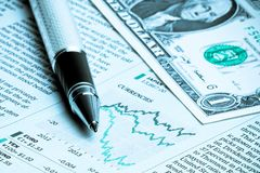 Detail of a business pen near one dollar Stock Image