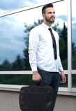 Detail of a businessman holding a briefcase Royalty Free Stock Images