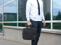 Detail of a businessman holding a briefcase Royalty Free Stock Photography