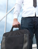 Detail of a businessman holding a briefcase Royalty Free Stock Image