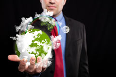 Businessman holding the world in his hand Royalty Free Stock Image
