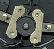 Detail of a camera mechanism. Detail of the mechanism of a 1920's 16mm camera Stock Photos