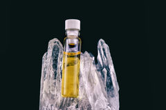 Detail of cannabis oil container and quartz crystal isolated on Stock Image