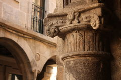 Detail of capitel. Medieval street stock photography
