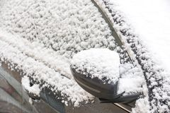 Detail of a car covered with snow. In winter royalty free stock image
