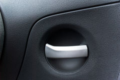 Detail of a car's handle. A close up of a car's door interior with the detail of the handle Stock Photography