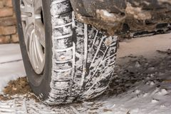 Winter tires in the snow on a car stock image