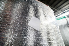 Detail of a cargo container packed in shiny foil thermal insulation. Royalty Free Stock Image