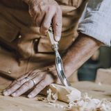 Carpenter`s hands use chiesel Stock Photos
