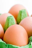 Detail of carton of eggs. Detail of free range eggs in green packaging carton royalty free stock images
