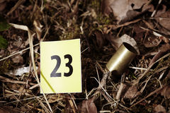 Detail of cartridge on place of crime Stock Photos
