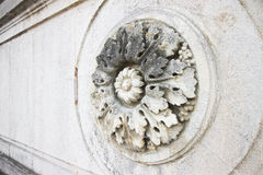 Detail of a carved circular stone flower Royalty Free Stock Photos