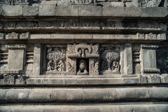 Detail of carved relief at Prambanan. Java, Indonesia. Prambanan or Candi Rara Jonggrang is a Hindu temple compound in Java, Indonesia, dedicated to the Trimurti stock photography