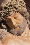 The detail of carved statue of Christ on the cross as the part of baroque Calvary. BANSKA STIAVNICA, SLOVAKIA - FEBRUARY 19, 2015: The detail of carved statue Royalty Free Stock Images