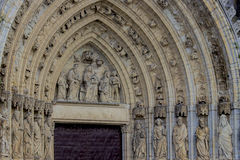 Detail carving up of the red door of church Royalty Free Stock Images