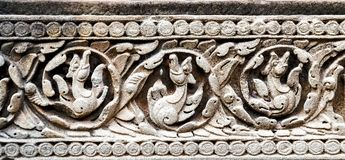 Bas-Relief Statue background of Khmer Culture in Angkor Wat, Cam. Detail of carvings background Bas-Relief Statue of Khmer Culture in Angkor Wat, Cambodia Stock Photos