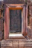 Bas-Relief Statue door of Khmer Culture in Angkor Wat, Cambodia Royalty Free Stock Photos