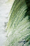 Detail of cascading water. Details of water cascading over small dam Stock Photography